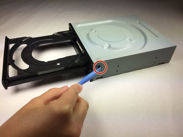 Use a plastic opening tool to push the three tabs located on the right, left, and bottom side of the outer chassis to loosen the faceplate off.