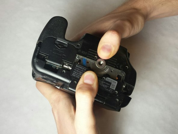 Once all of the screws are out, open the camera like shown in the picture