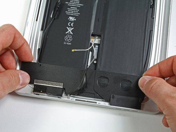 Image 1/2: Remove the speaker assembly from the rear panel assembly.