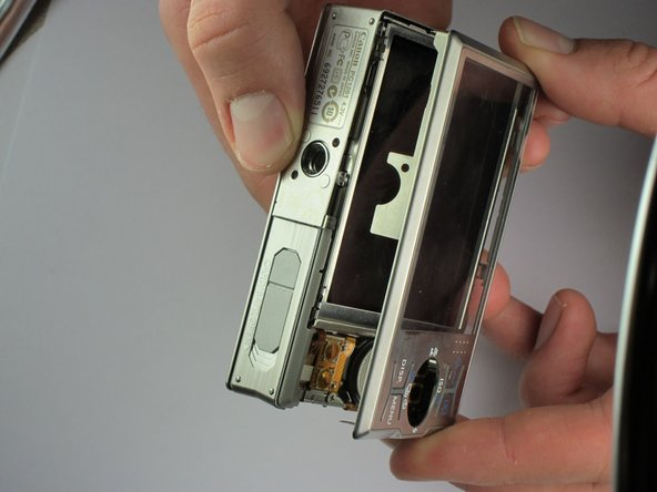 Image 3/3: Once the side plate and front cover are in place, the screen cover will snap back onto the camera.