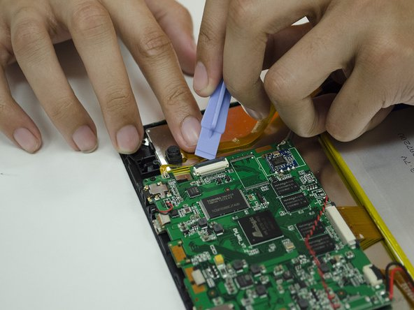 Use your fingernails or a plastic opening tool to remove any remaining ribbon cables from the Motherboard.