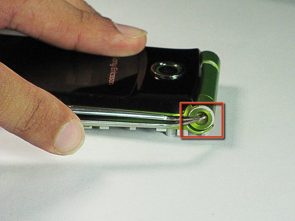 Use tweezers to push the hinge stopper in until it can no longer be moved.