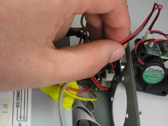 Image 3/3: Gently pull fan cord from connection and remove fan completely.