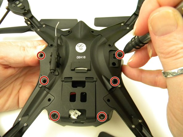 Remove the six (6) 5mm screws attaching the Body Cover to the Body of the drone using a JIS #00 screwdriver.
