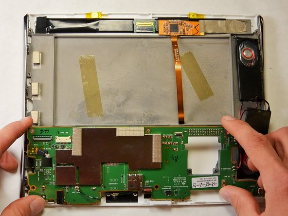 Flip the green electrical board back so that the screen is separated from the green board.