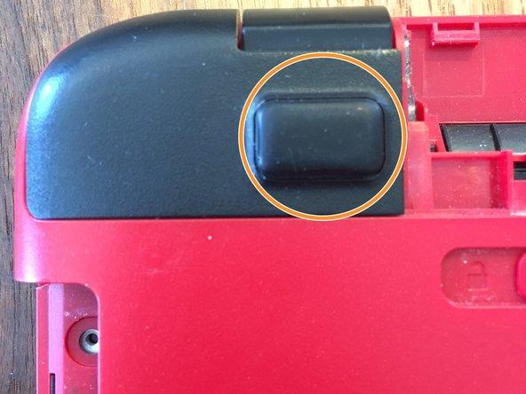 Image 1/3: Remove the single screw underneath the cap.