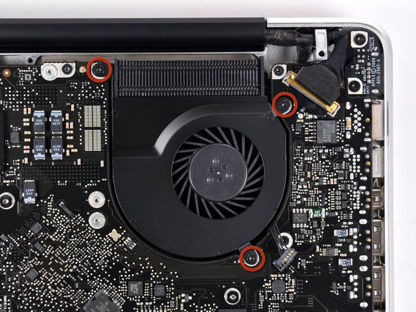 Remove three T6 Torx screws securing the left fan to the logic board.