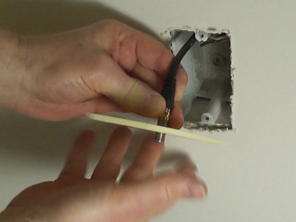 Remove the existing wall plate by unscrewing it from the coaxial cable in the wall.