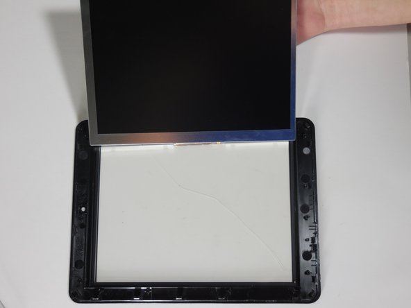 Pry up the LCD display and lift it away from the plastic screen.
