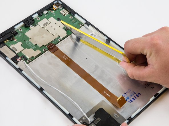After the battery is totally free of any adhesion, simply lift the battery from the case.