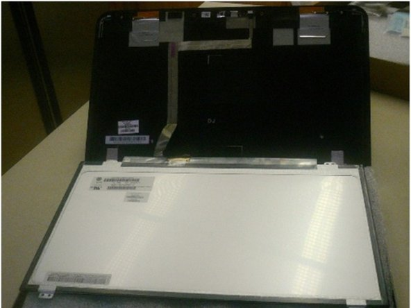 Remove screen from back panel and lay it on the keyboard