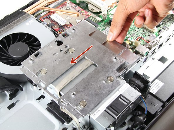 "Remove both 3/8"" screws using the T15 Torx Screwdriver from the metal plate, and slide the plate to the left."