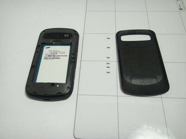 Use the Phillips #00 Precision Screwdriver to remove the six screws in the back of the phone.