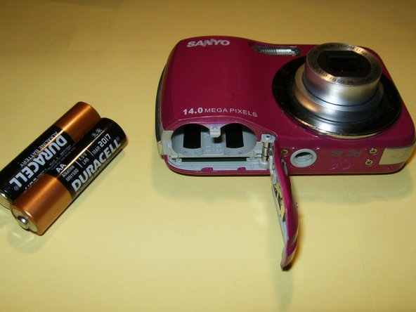 Remove the batteries and the memory card if so equipped.
