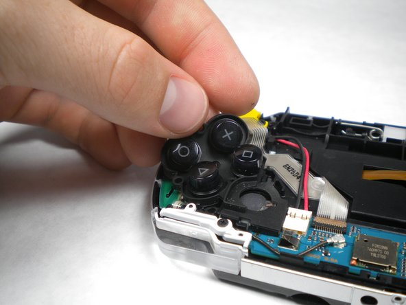 Remove the button pad from the PSP.