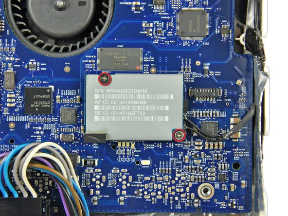 Remove the two Phillips or two T6 Torx screws securing the AirPort/Bluetooth board to the logic board.