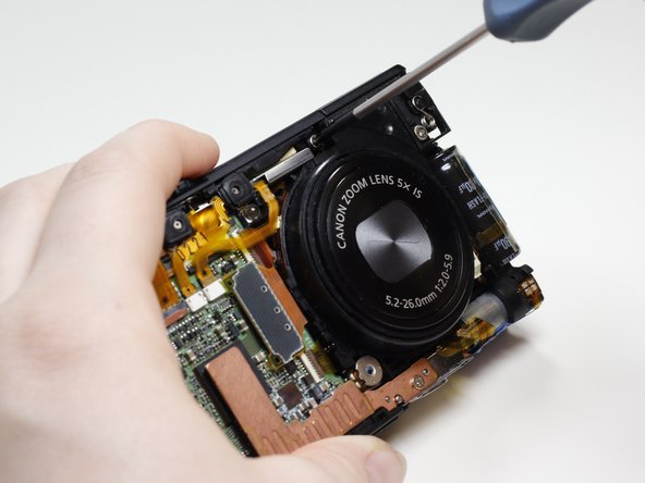 Image 2/2: Remove the screw (2.9mm, Phillips #00) that is directly above the camera lens.