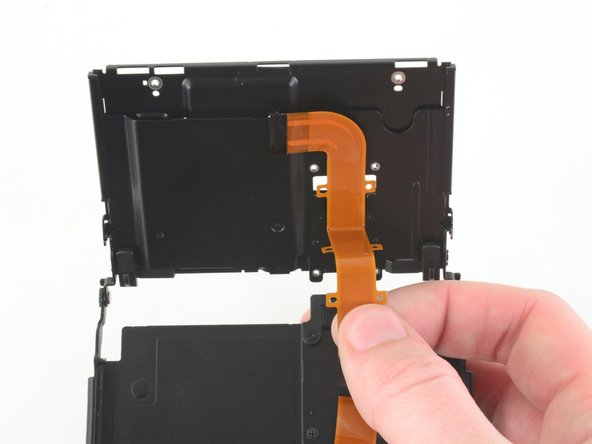 Pull the ribbon cable through the hole in the LCD assembly.