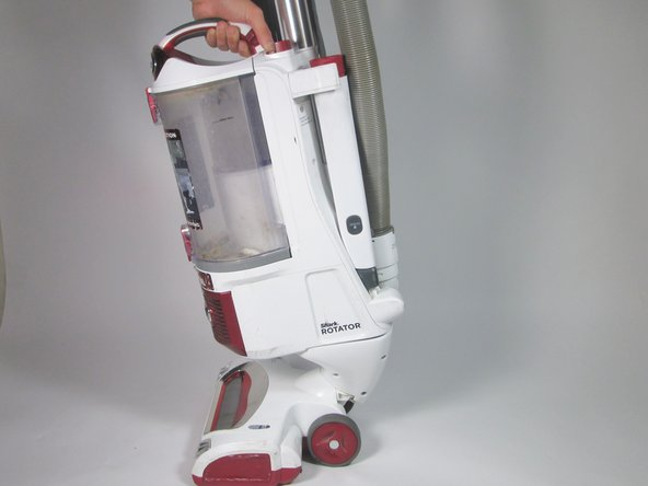 Pull the handle while pressing the lift away button to remove the body of the vacuum.