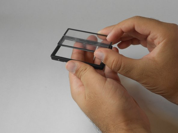 Using your hand, lift the detached plastic cover off the plastic frame.