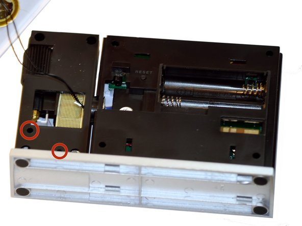 Use a Phillips #00 Screwdriver to remove two (2) screws from back of projection arm.