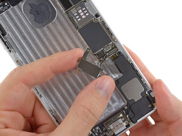 Lift and remove the vibrator out of the iPhone.