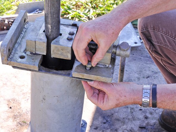Secure the riser main with the base clamp.