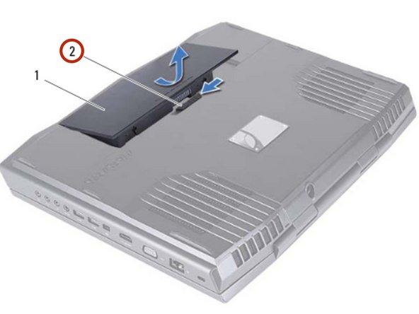 Deslice el pestillo de la batería a la posición de desbloqueo como se muestra. La batería aparece.