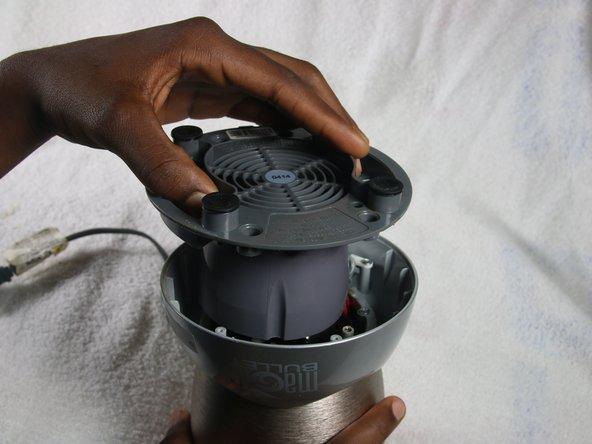 Unscrew the four 1 cm screws using #2 Phillips Head Screwdriver.