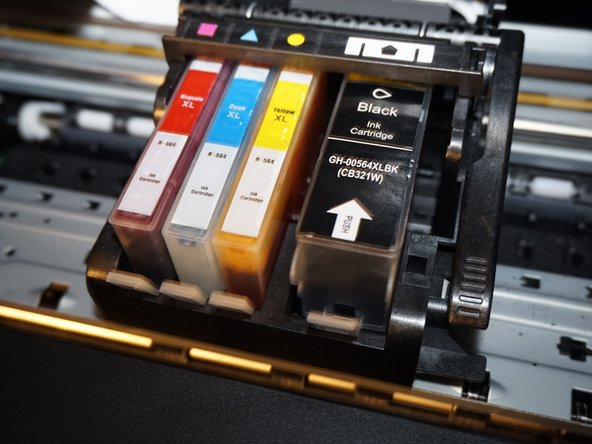 Image 1/3: Once the old ink cartridge(s) have been removed, open your new ink cartridge(s) and install the replacement ink cartridge. Push down by the locking tab to ensure the ink cartridge is securely installed.
