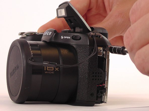 Remove the 4mm screws from the left and right sides of the camera.