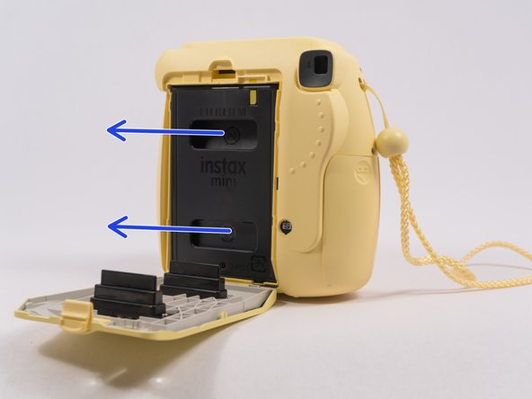 Open up the back and remove the film cartridge.