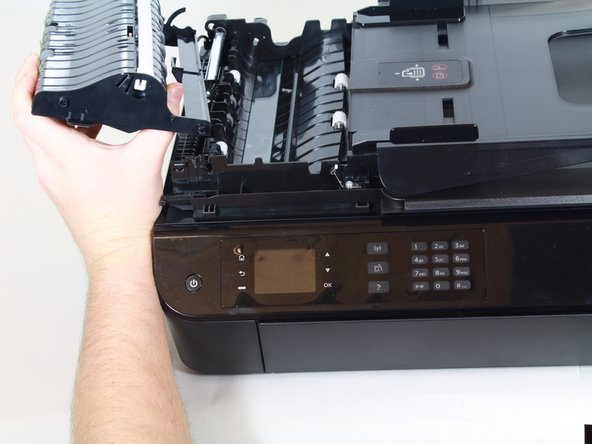 There is still a cable holding the part to the rest of the printer.