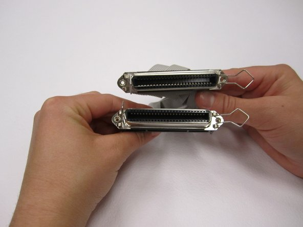 Once the screws are removed, the two connections are easily removed from the body.