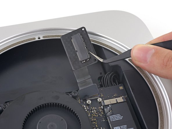 Remove the PCIe SSD cable from the Mac mini.
