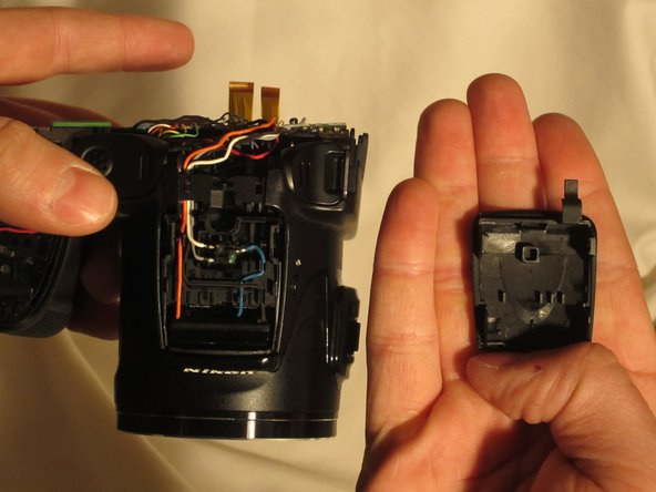 From here, the panel covering the flash bulb can be removed.