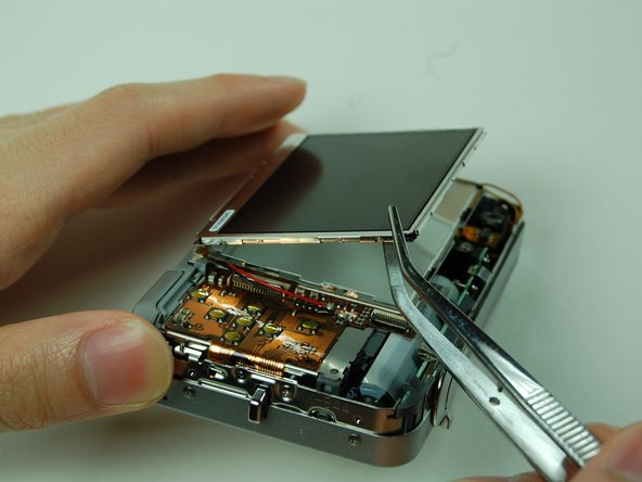 Lift up the LCD screen, slowly move it to the other side.