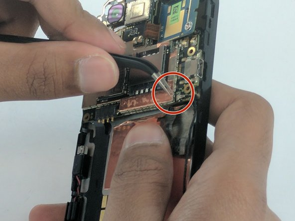Remove the power supply from the motherboard by gently pulling the end of the black wire with the precision tweezers.