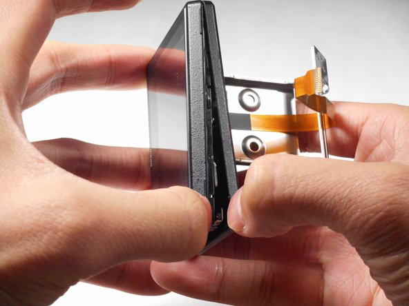 Using your fingers, remove the two plastic borders that case the LCD screen.