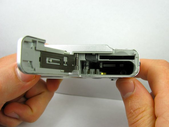 The cover will spring open, revealing the battery compartment. Here is where you will remove or install the battery.
