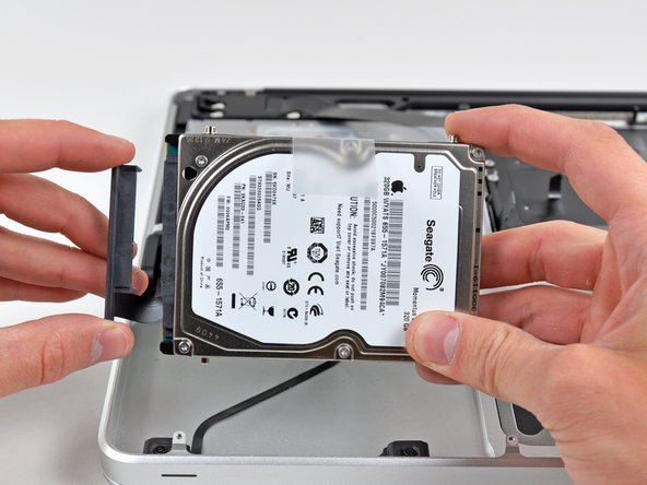 Image 2/2: Remove the hard drive and set it aside.