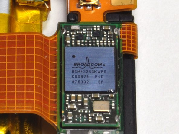 Image 2/2: At the top of the picture above the battery is a metal cover. Underneath the cover is a Broadcom [http://www.broadcom.com/products/Bluetooth/Bluetooth-RF-Silicon-and-Software-Solutions/BCM4325|BCM4325] Wi- Fi and Bluetooth chip. Yes, that's right, Bluetooth! Apple has said nothing of this publicly.