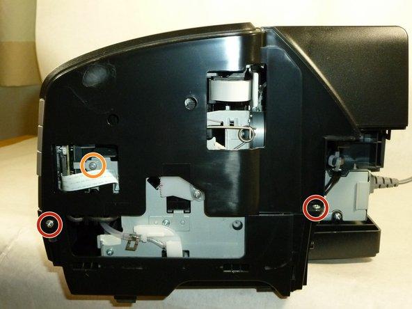 Image 2/3: Remove the three 6mm Phillips #2 screws.