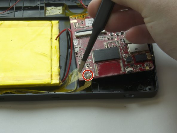 Use tweezers to gently lift the yellow tape that tapes down the yellow flat cable.