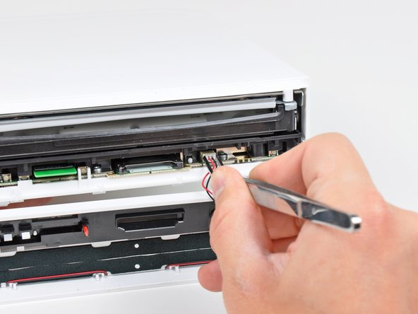 Use a pair of tweezers to disconnect the LED cable's plastic connector from the motherboard.