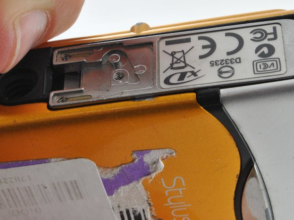 Close the memory card latch/ battery latch.