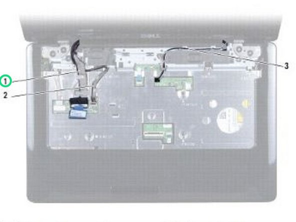 Route the display cable and camera cable into their routing guides and connect the cables to the respective system board connectors.