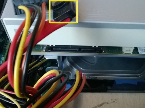 First find the two cables going into the optical drive - they are shown in the first picture.