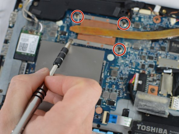 Remove heat sink by unscrewing the four 3 mm JIS #1 head screws