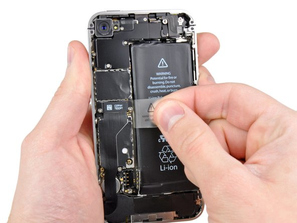 Pull up on the exposed clear plastic tab to peel the battery off the adhesive securing it to the iPhone.